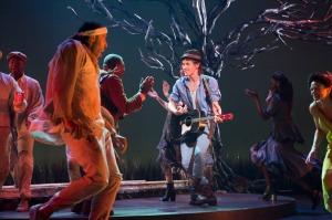 Actors and musicians dancing.