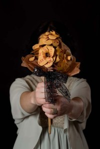 A woman holding a bouquet.